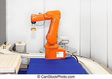 Robotic arm at automated factory production line