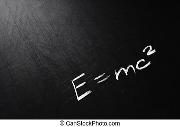 E=mc2 - Conceptual phrase written on school board by chalk