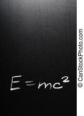 E=mc2 - Conceptual phrase written on school board by chalk