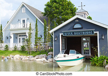 Boatshed on the River in blue house