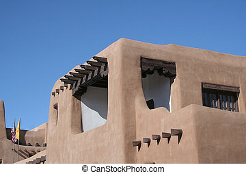 Adobe House - Adobe style building with wood beams