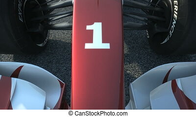 F1 race car at start position accel - driving behind Formula...