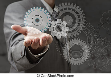 hand shows cogwheels as concept
