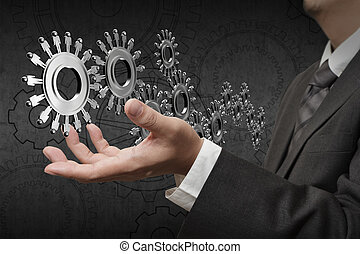 gears or cogs as human worker symbols