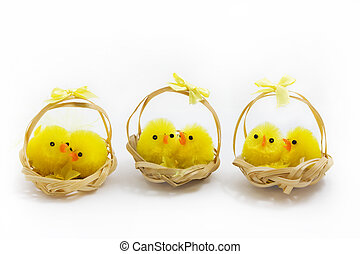 three baskets of easter chicks over white