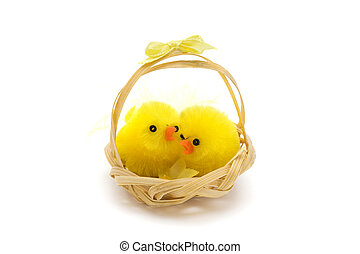 two easter chicks in a basket over white