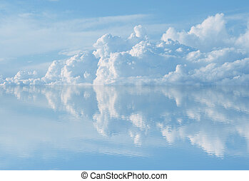 blue sky reflecting on water,