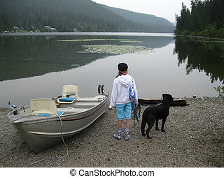Girl and dog ready to go boating - Waiting on the shore and...