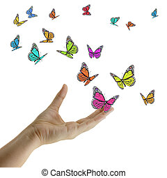 Hand releasing exotic butterflies. - Hand releasing exotic...