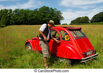 French man with his typical red car - Typical French man is...