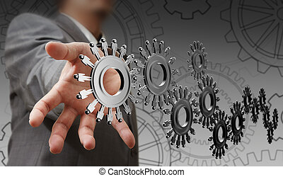 businessman hand shows people cogs as concept