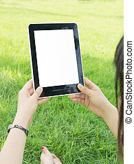 Tablet PC hand - Woman hands holding electronic tablet pc...