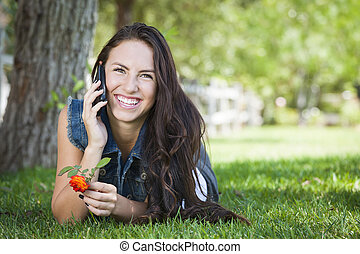 Mixed Race Young Female Talking on Cell Phone Outside