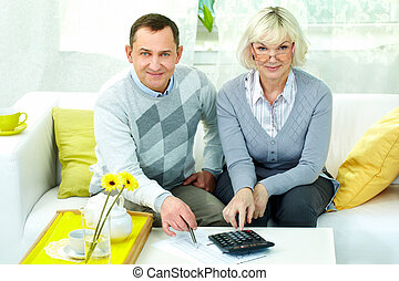 Pensioners at home - Portrait of mature man and his wife...
