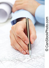 Engineering work - Close-up of engineer hand with pen over...