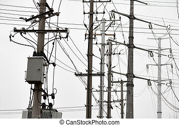 Electricity poles with messy connections on white background
