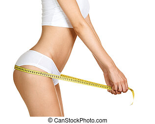 Woman measuring perfect shape of beautiful hips. Healthy lifestyles concept