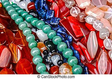 Trinkets 24 - Different colored trinkets displayed in the...