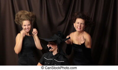 Scary Dance - Three witches having fun performing a lind of...
