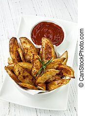 Potato Wedges with Ketchup - Potato wedges in a bowl, with...