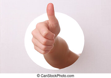 Thumbs up - Arm reaches trough a hole with thumbs up