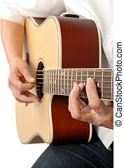 Playing the acoustic guitar - Female guitar player's hands...