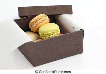 Colorful Macaron in paper box isolated on white background