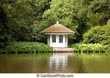 little house in rich garden on the embankment of the river...