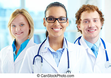 Pretty clinician - Portrait of three clinicians in white...