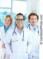 Friendly doctors - Portrait of three clinicians in white...