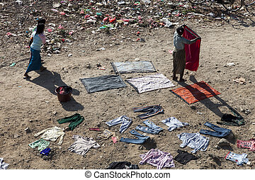 woman wark for drying clothes on the ground, Myanmar near...