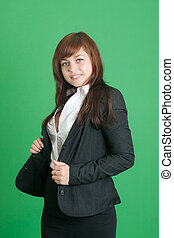 the girl in a black suit on a green background