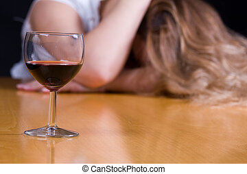 alcoholic - young woman passed out from alcohol