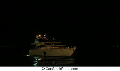 A boat at night - A boat sailing in the sea at night