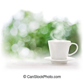 Cup of hot drink on defocus summer background