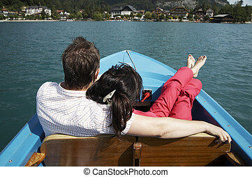 young couple boating on the lake in Austria