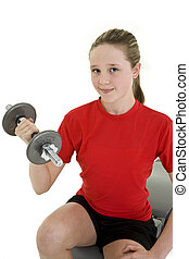 Lifting weights - Caucasian preteen female lifting weights...