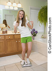 Weight Issues - Caucasian preteen very excited about her...