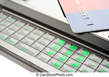 Mobile banking - Close view of smartphone with credit card.