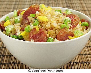 Sausage Fried Rice - A bowl of fried rice with Chinese...