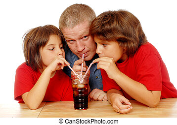 Sipping Soda Together - A father and two daughters drinking...