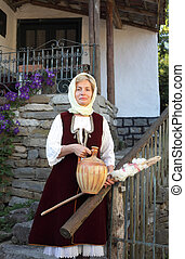 Folk costumed woman - Woman dressed in antique Bulgarian...
