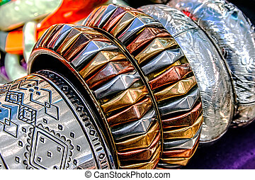 Bracelets and Jewelry - Different colored trinkets displayed...