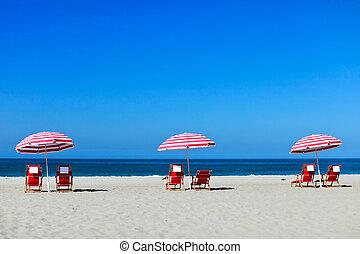 Santa Monica beach - Three sun umbrellas at Santa Monica...