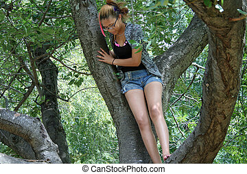 Gnarled Southern Magnolia Tree - Girl sitting in gnarled...