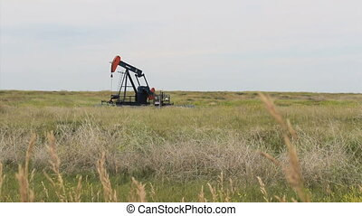 Oil Pump In The Middle Of Prairies - A lonely oil pump works...