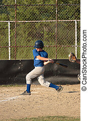 Baseball Batter - Youth Teen baseball batter striking out.