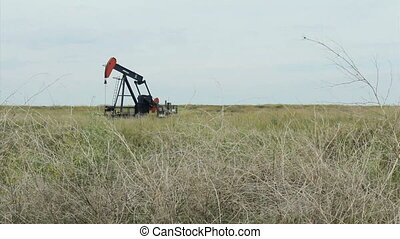 Oil Pump In Scrub Grass - A lonely oil pump works tirelessly...