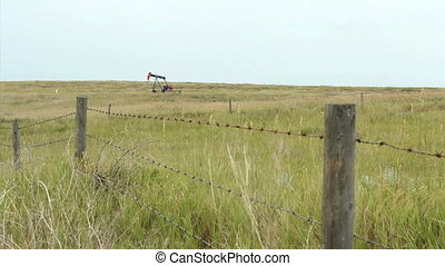 Lonely Oil Pump On Farm - A lonely oil pump works tirelessly...