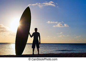 Silhouette of man with paddle board - Silhouette of man...
